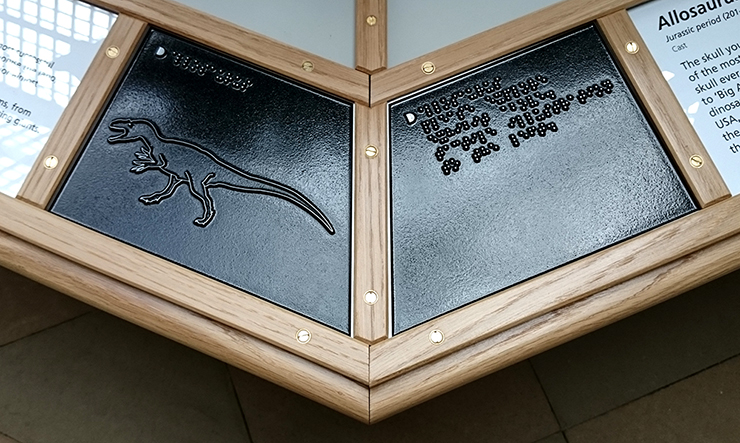 A metal tactile line drawing of an Allosaurus.